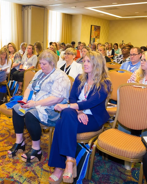 Our President, Betsy, sitting in the front row at an AADOM conference